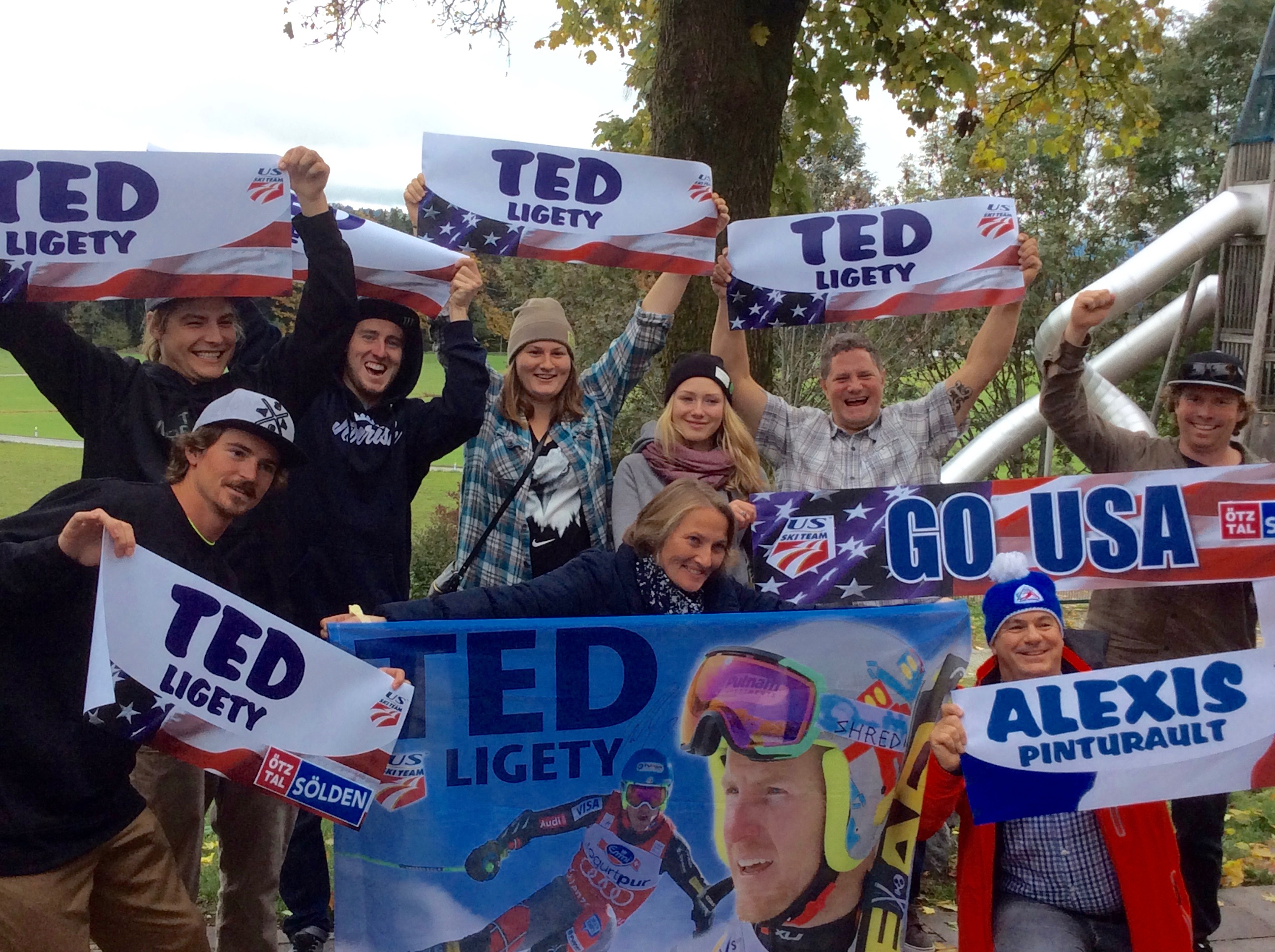 U.S Ski team athletes cheering Ted LIGETY